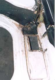 view of rusty battery box
